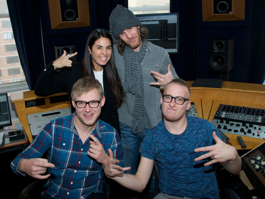 Mastering engineer Emily Lazar poses with producer Scott Jacoby (top right) and members of the band School is Cool at her Manhattan studio, The Lodge.