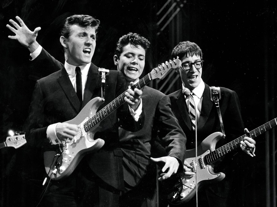 The Shadows on stage in the 1960s. The British rock act, formed as a backing band for singer Cliff Richard (center), was among the UK acts who stayed behind as The Beatles and others were cresting in America.