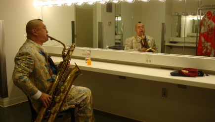 Fred Ho practices his baritone in a dressing room before a performance.