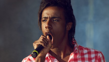 Mo performs in 2011, the year he rose to prominence on Norway's version of The X Factor.
