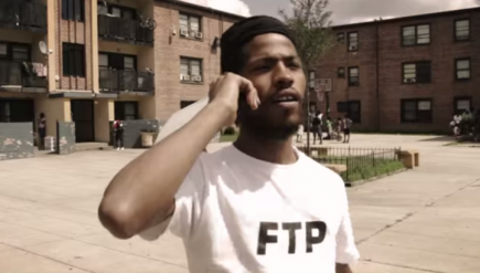 D.C. rapper Yung Gleesh turned himself into police in Austin on Tuesday after being charged with sexual assault.