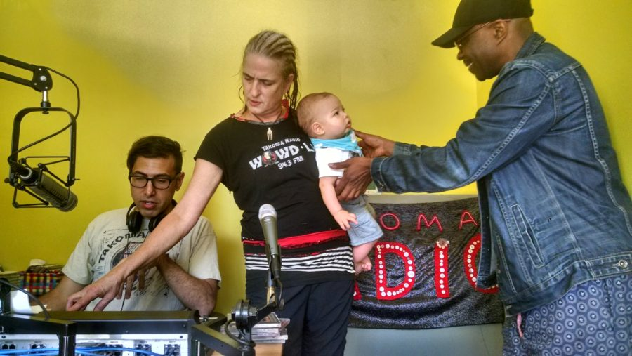 "All ages show: Takoma Radio founder Marika Partridge holds the baby of a community member at an ""open studio"" earlier this year."