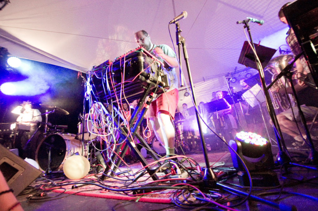 Dan Deacon ensemble, including more than 20 members with a variety of instruments, performed Saturday night at Fields Festival
