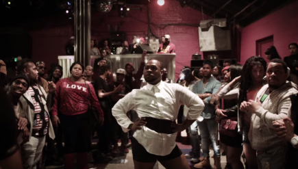 "Keith ""Ebony"" Holt performs in a Baltimore ballroom event as depicted in the video ""Voguing for a Cause."""